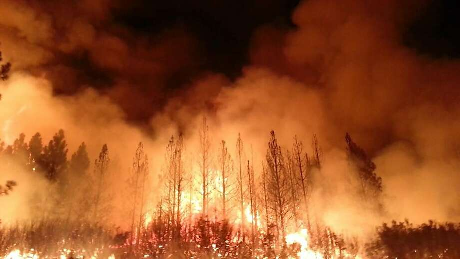 This photo obtained August 23, 2013 courtesy of the US Forest Service, shows the Rim Fire as it burns near Yosemite National Park, California. The wildfire outside Yosemite National Park,  is one of more than 50 major brush blazes burning across the western United States , has more than tripled in size overnight and still threatens about 2,500 homes, hotels and camp buildings. Fire officials say that the blaze burning in remote, steep terrain has grown to more than 84 square miles and was only 2 percent contained on August 22, 2013, down from 5 percent a day earlier. Photo: Ho, AFP/Getty Images