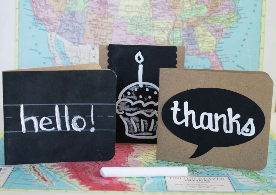 Handmade notecards are made by spraying cardstock with chalkboard paint. Incorporate old-school elements like chalkboards, vintage maps, notebook paper and brown paper lunch sacks. Photo: Holly Ramer, STF / AP