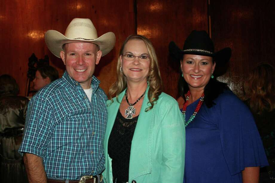 Sean Gutierrez, Janet Meyer, center, and Tammy Osina-Felinski, dentist, were among the crowd shopping from the numerous vendors before going to dinner. Gutierrez and Osina-Felinski are Fort Bend County Fair board members, and Osina-Felinski was one of the directors in charge of the event. Meyer, of Corral Western Wear, was a sponsor.