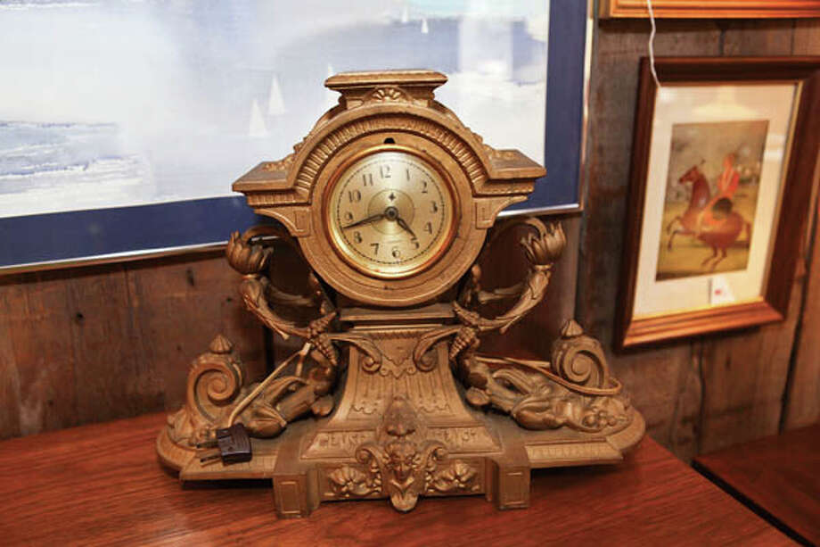 Desk Clock A plug-in timepiece boasting ornate 1930s-era metal. $300 at Vintage Art.