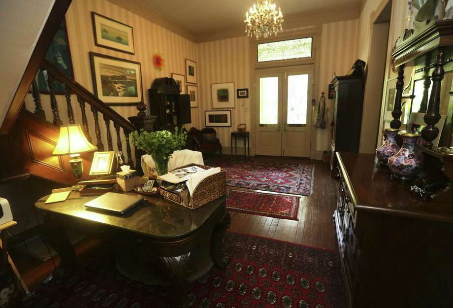 The entry way in the King William home of Kit Walker and Deb Field holds a desk converted from an antique piano. The house was built in 1878. Photo: Photos By Bob Owen / San Antonio Express-News