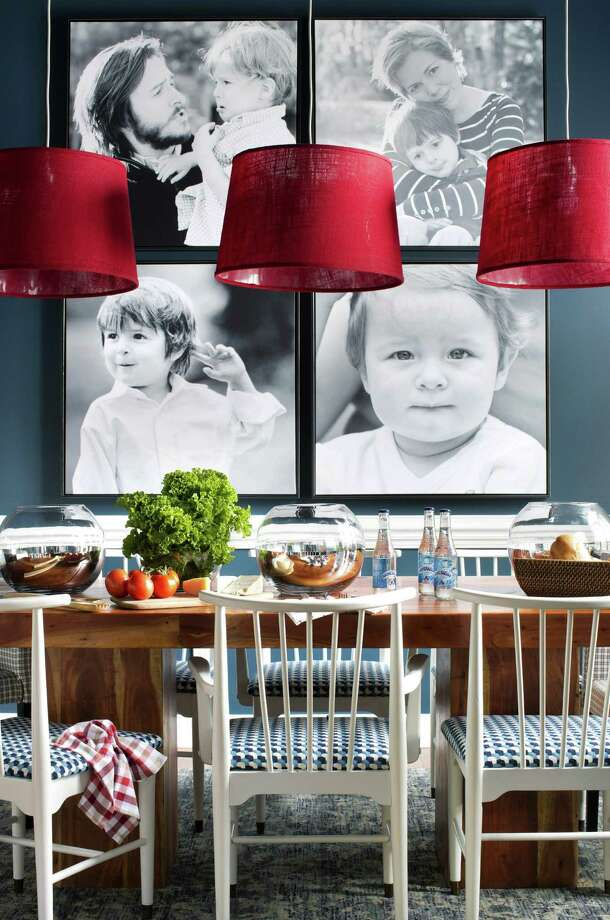 Interior designer Brian Patrick Flynn used a family's photos as dining room art. Photo: HGTV.com