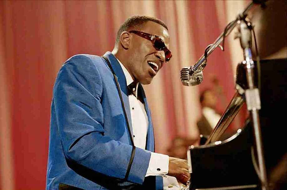 "Jamie Foxx as Ray Charles in ""Ray"" – We knew he could play piano, but we wondered if we'd be watching a real actor or just a Ray Charles impersonator."