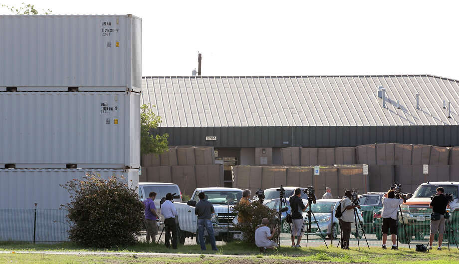 Media members gets a closer view of the heavily fortified M.G. Williams Judicial Center on the first day of the capital murder trial of U.S. Army Lt. Nidal Malik Hasan at Fort Hood, Tuesday, August 6, 2013. Hasan is facing 13 counts of premeditated murder and 32 counts of attempted premeditated murder in the shooting rampage at Fort Hood on Nov. 5, 2009. Photo: San Antonio Express-News / ©2013 San Antonio Express-News