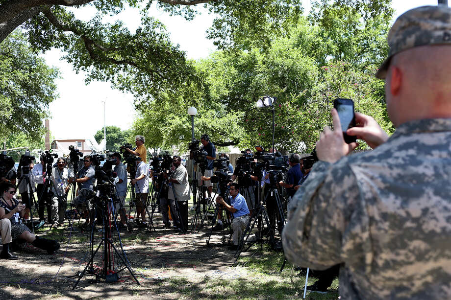 A public affairs officer photographs the media as they wait for Tom Rheinlander, Director of Public Affairs at Fort Hood, to make a statement during the first break on the first day of the trial for Maj. Nidal Hasan at Fort Hood in Killeen on Tuesday, August 6, 2013. Photo: Lisa Krantz, San Antonio Express-News / San Antonio Express-News