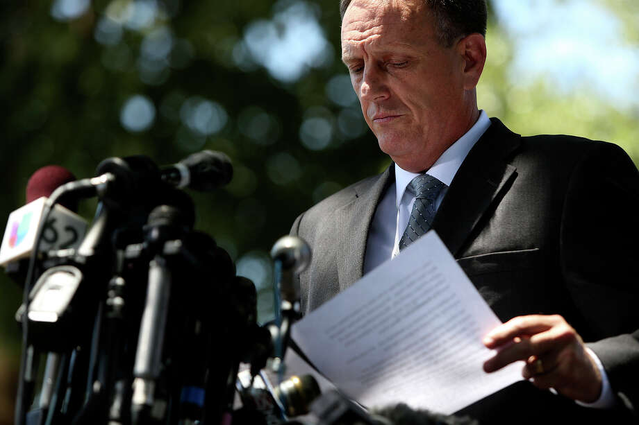 Tom Rheinlander, Director of Public Affairs at Fort Hood, makes a statement to the media during the first break on the first day of the trial for Maj. Nidal Hasan at Fort Hood in Killeen on Tuesday, August 6, 2013. Photo: Lisa Krantz, San Antonio Express-News / San Antonio Express-News