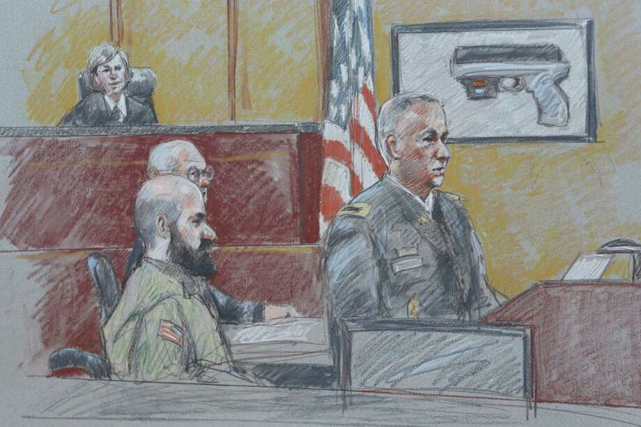 This courtroom sketch shows military prosecutor Lt. Col. Steve Henricks, right, speaking as Nidal Malik Hasan, center, and presiding judge Col. Tara Osborn look on during his court-martial Tuesday, Aug. 6, 2013, in Forth Hood, Texas.  Hasan is representing himself against charges of murder and attempted murder for the 2009 attack that left 13 people dead at Forth Hood. (AP Photo/Brigitte Woosley) Photo: Brigitte Woosley, Associated Press / AP