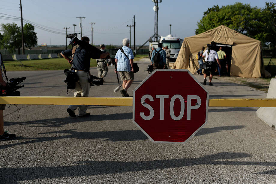 Photojournalists go through a security checkpoint to get a closer to the Lawrence H. Williams Judicial Center on the second day of the trial for Maj. Nidal Hasan at Fort Hood in Killeen on Wednesday, August 7, 2013. Photo: Lisa Krantz, San Antonio Express-News / San Antonio Express-News