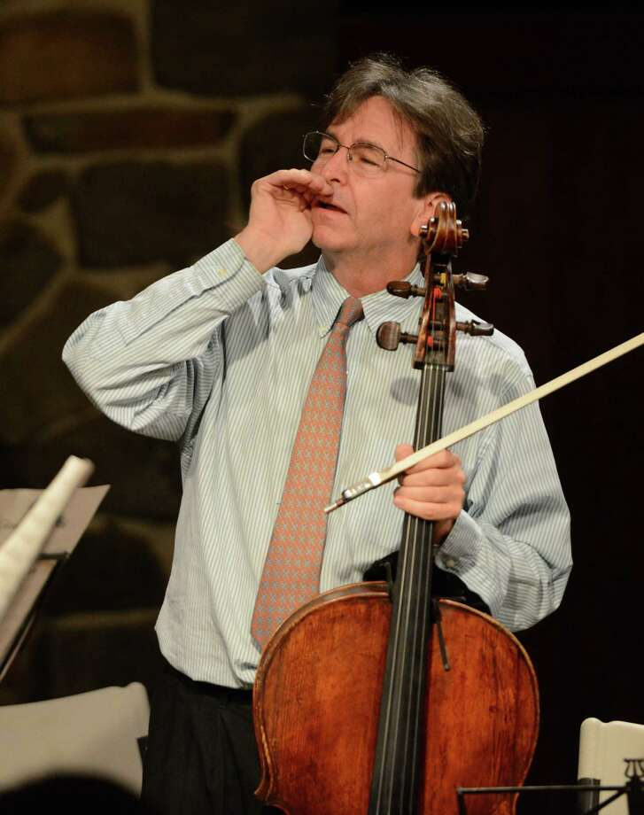 Eliot Bailen, cellist and director of the Sherman Chamber Ensemble, welcomes guests before his group's performance at the Lake Mauweehoo Clubhouse in Sherman, Conn. on Saturday, Aug. 10, 2013. The group has several more performances coming up this weekend. Photo: Tyler Sizemore / The News-Times