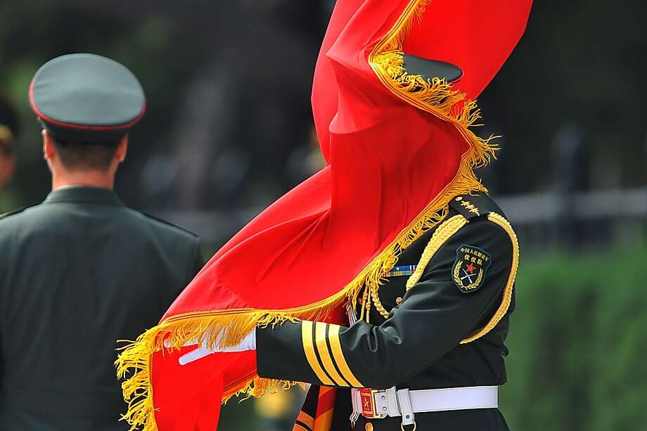 The age-old enemy of the honor guard- a gust of wind - causes an awkward moment at the   welcoming ceremony for Argentine Vice President Amado Boudou and Chinese Vice President   Li Yuanchao outside the Great Hall of the people in Beijing. Photo: Wang Zhao, AFP/Getty Images
