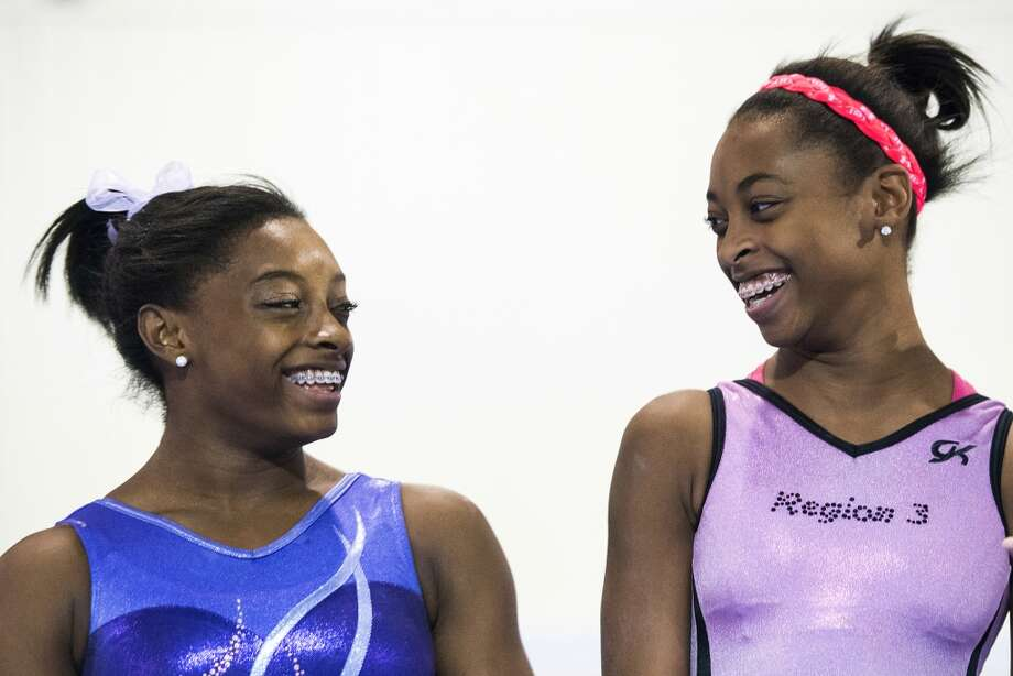 Simone Biles, left, laughts with her sister Adria while they train at Bannon's Gymnastix. Photo: Smiley N. Pool, Houston Chronicle