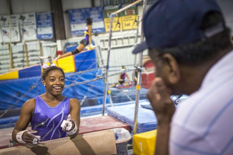 Simone Biles talks with her father Ron Biles during a training session. Photo: Smiley N. Pool, Houston Chronicle