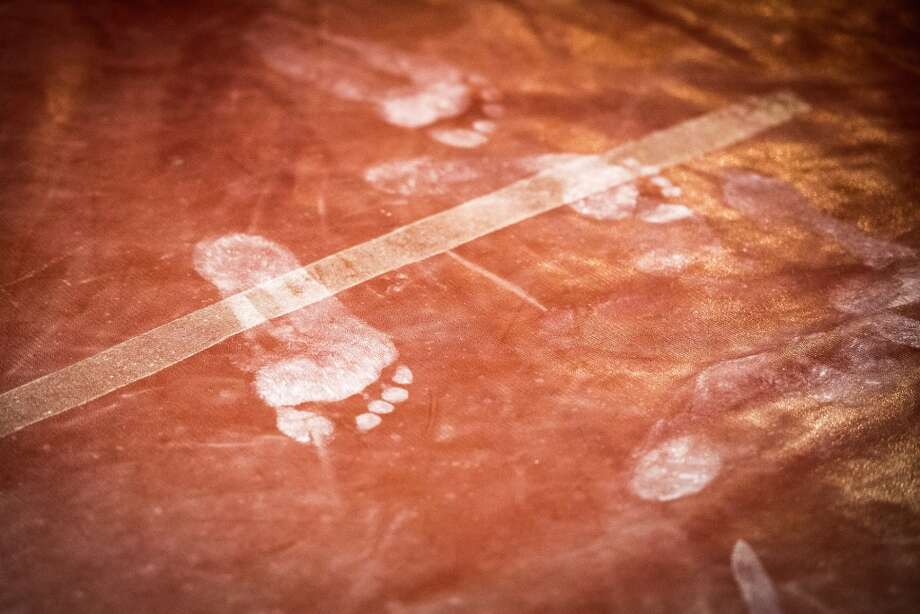 Chalk leaves footprints on the mats at Bannon's Gymnastix. Photo: Smiley N. Pool, Houston Chronicle