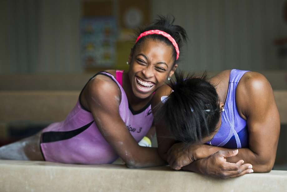Simone Biles, right, laughts with her sister Adria during training at Bannon's Gymnastix. Photo: Smiley N. Pool, Houston Chronicle