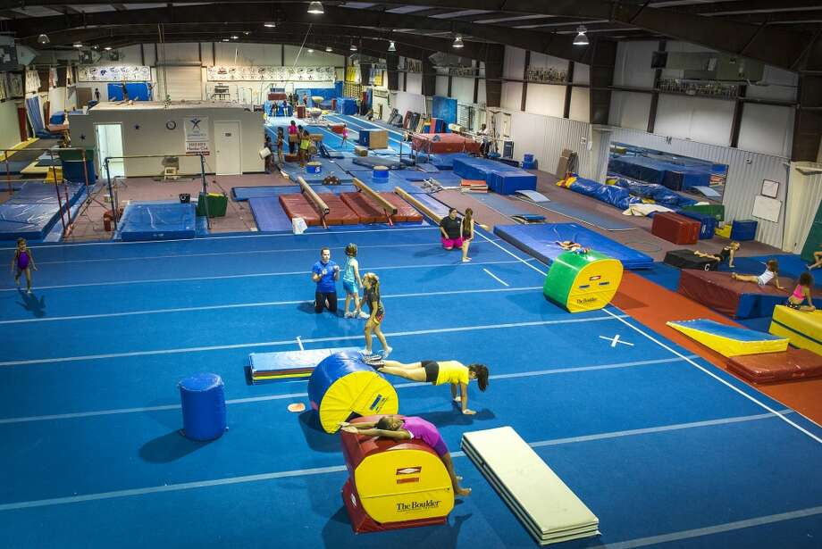 Youngsters train at Bannon's Gymnastix. Photo: Smiley N. Pool, Houston Chronicle