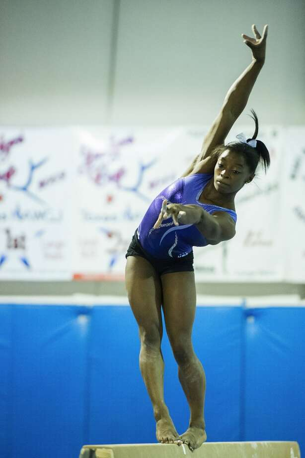 Simone Biles trains on the balance beam. Photo: Smiley N. Pool, Houston Chronicle