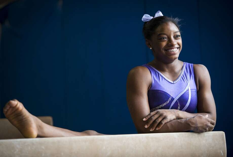 Simone Biles stretches after training at Bannon's Gymnastix. Photo: Smiley N. Pool, Houston Chronicle