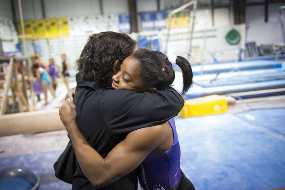 Simone Biles hugs her mother Nellie Biles as she trains at Bannon's Gymnastix on Thursday, Aug. 22, 2013. Photo: Smiley N. Pool, Houston Chronicle