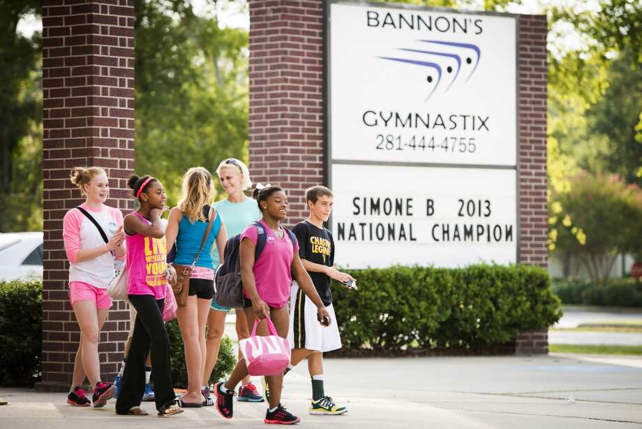 A sign celebrates her victory in as the USA Gymnastics womenÕs all-around national championship as Simone Biles leaves after training at Bannon's Gymnastix on Thursday, Aug. 22, 2013. Photo: Smiley N. Pool, Houston Chronicle