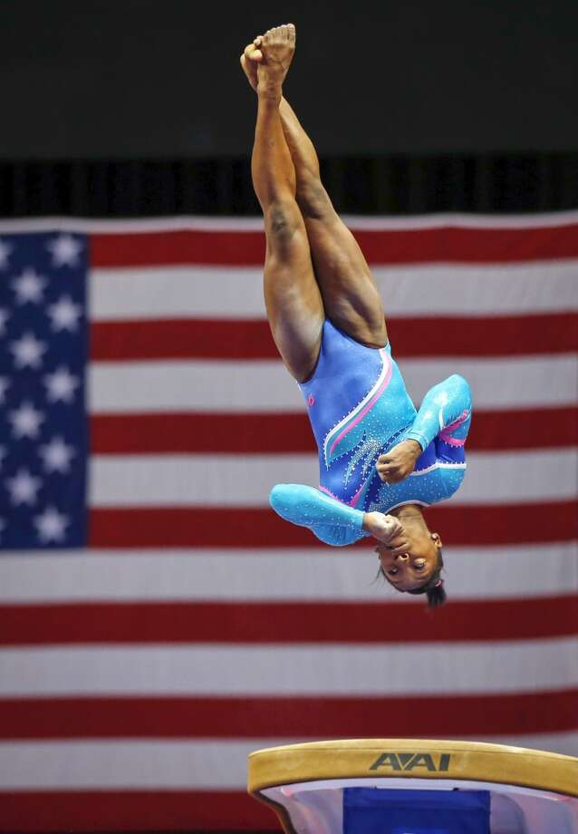 Simone Biles competes on the vault during the U.S. women's national gymnastics championships in Hartford, Conn. Thursday, Aug. 15, 2013. Photo: Elise Amendola, Associated Press