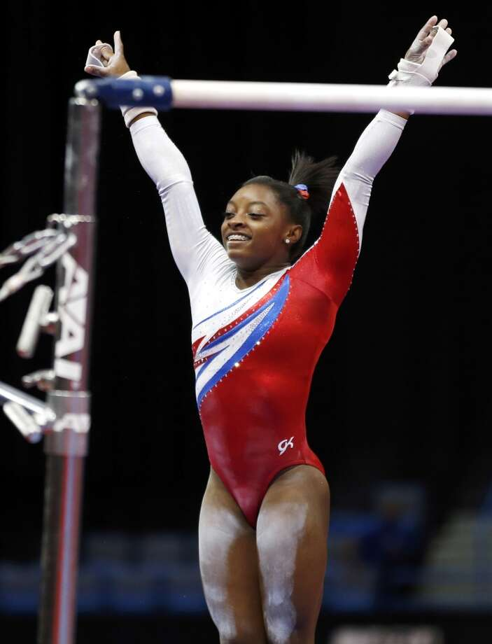 Simone Biles reacts after finishing on the uneven bars during the U.S. women's national gymnastics championships in Hartford, Conn., Saturday, Aug. 17, 2013. Photo: Elise Amendola, Associated Press
