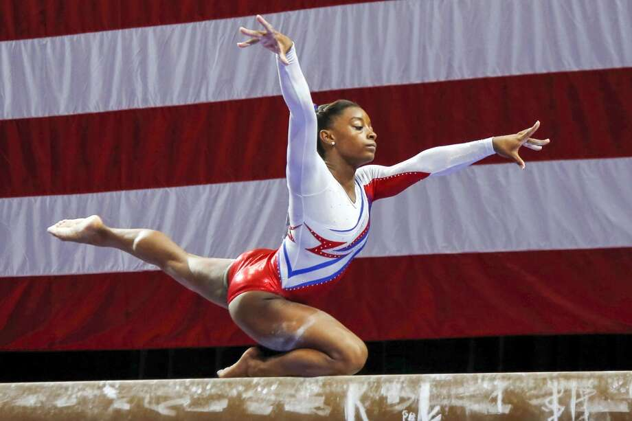 Simone Biles competes on the balance beam during the U.S. women's national gymnastics championships in Hartford, Conn., Saturday, Aug. 17, 2013. Photo: Elise Amendola, Associated Press
