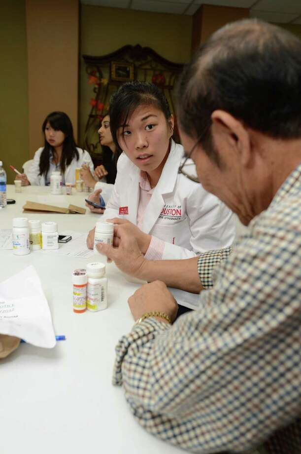 Counseling patients on safe, effective medication use to improve patient outcomes is among the areas of emphasis in the professional pharmacy degree program. Pei Lin (shown) counsels a senior on his multiple medications.
