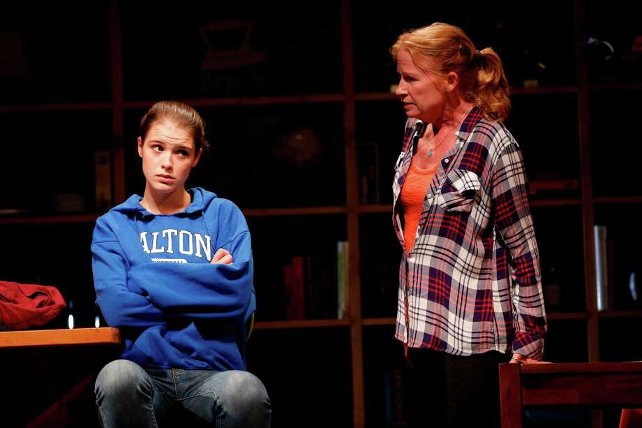 "Katie Broad as 16-year-old Julie and Johanna Day as her mother, Pam, in a scene from ""Oblivion"" at the Westport Country Playhouse. Julie's parents think of themselves progressive parents, but that facade crumbles when Julie refuses to tell them where she spent the past weekend. Photo: Contributed Photo / Westport News"