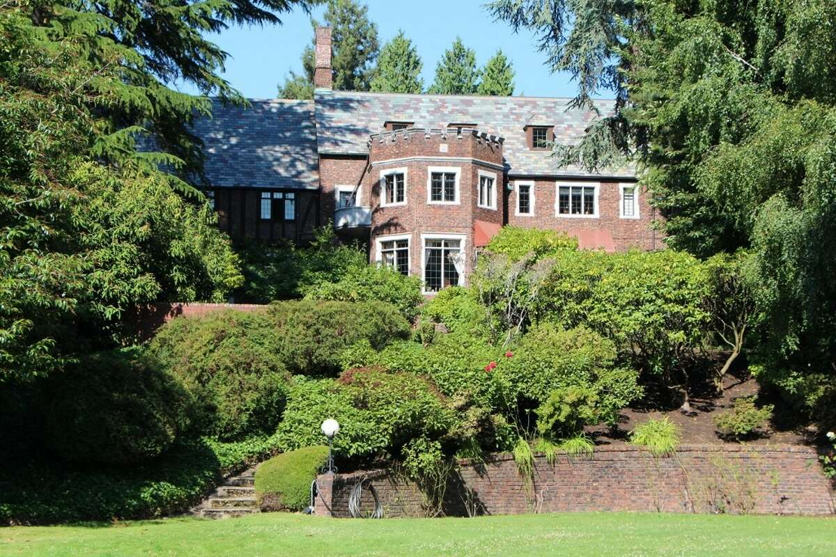 Old Seattle estates don't get much grander than 7326 Bowlyn Place S., on the edge of Lake Washington in Seward Park. The 12,380-square-foot mansion, built in 1930, has seven bedrooms, 6.75 bathrooms, four fireplaces, a family room, a den, a game room, a bar and a wine cellar, on a landscaped 3.1-acre lot with a 1,500-square-foot beachfront guest house, a man-made island, a hot tub, a dock, and jet ski and boat lifts. It's listed for $7.2 million.