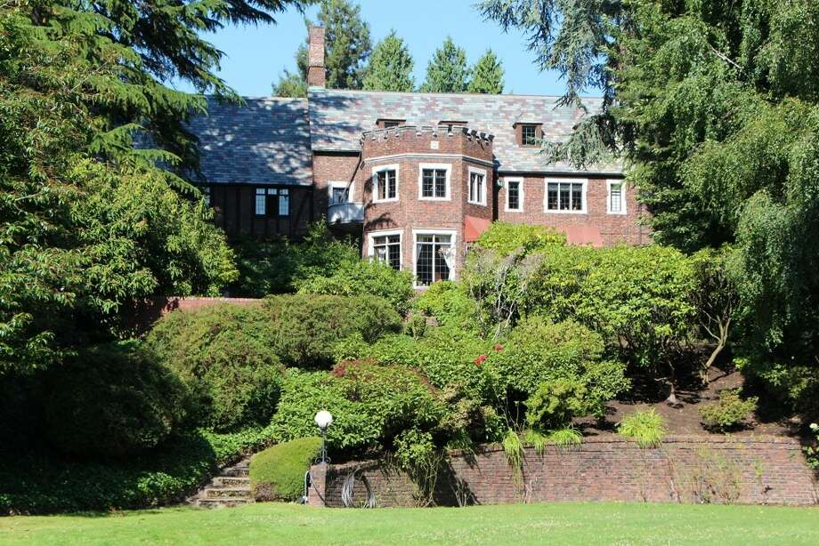 Old Seattle estates don't get much grander than 7326 Bowlyn Place S., on the edge of Lake Washington in Seward Park. The 12,380-square-foot mansion, built in 1930, has seven bedrooms, 6.75 bathrooms, four fireplaces, a family room, a den, a game room, a bar and a wine cellar, on a landscaped 3.1-acre lot with a 1,500-square-foot beachfront guest house, a man-made island, a hot tub, a dock, and jet ski and boat lifts. It's listed for $7.2 million. Photo: Courtesy Brad Vancour,  Realogics Sotheby's International Realty