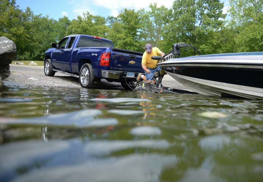 Kevin Hart, of Torrington, loads his boat onto a trailer at the Lake Lillinonah State Boat Launch on Route 133 in Bridgewater, Conn. on Friday, Aug. 23, 2013.  The area will be closed from Sept. 3 through Dec. 31 while the boat launch is being reconstructed and facilities enhanced.  During the renovations, boaters can use the launch areas at Pond Brook on Lake Lillinonah, Lake Zoar in Southbury, and Squantz Cove on Candlewood Lake among others. Photo: Tyler Sizemore / The News-Times
