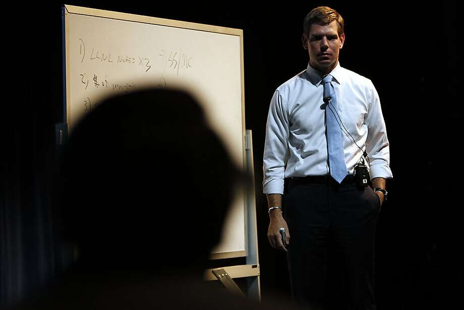 Rep. Eric Swalwell speaks to constituents during a forum at Las Positas College. Photo: Sarah Rice, Special To The Chronicle