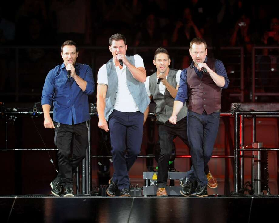In this photo provided by the Las Vegas News Bureau, 98 Degrees performs performs at the Mandalay Bay Events Center in Las Vegas on Saturday, July 6, 2013. (AP Photo/Las Vegas News Bureau, Brian Jones)  ORG XMIT: NVNB102 Photo: AP