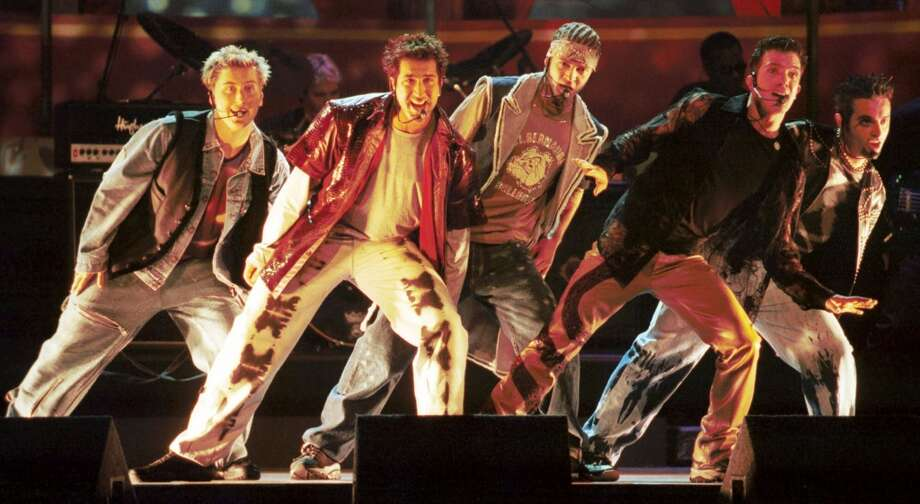 FILE--Vocal group 'N Sync performs at the 9th annual MTV Movie Awards at Sony Studios in Culver City, Calif., in this June 3, 2000, file photo.  'N Sync will sing the national anthem at the Jayson Williams Celebrity Softball Challenge on July 29, 2001, at Riverfront Stadium in Newark, N. J.  (AP Photo/Chris Pizzello, File) Photo: AP
