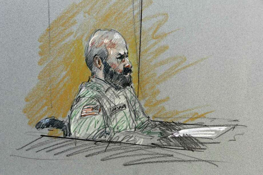 Maj. Nidal Malik Hasan sits in court for his court-martial in this courtroom sketch. A reader says executing him would elevate him to the status of a martyr and spark violent reactions. Photo: Sketch By Brigitte Woosley / Associated Press