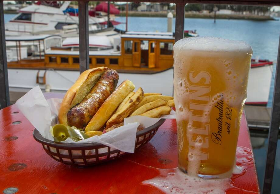 The homemade Sausage Sandwich ($8.50 or $10 with fries) with a Veltins Pilsner at Brotzeit. Photo: John Storey, Special To The Chronicle