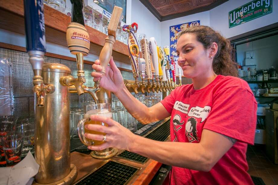 Bartender Krista Granieri pours a beer at Brotzeit. Photo: John Storey, Special To The Chronicle