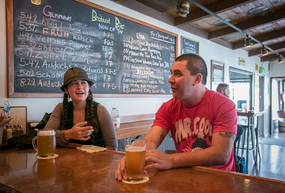 People enjoy beers at Brotzeit. Photo: John Storey, Special To The Chronicle
