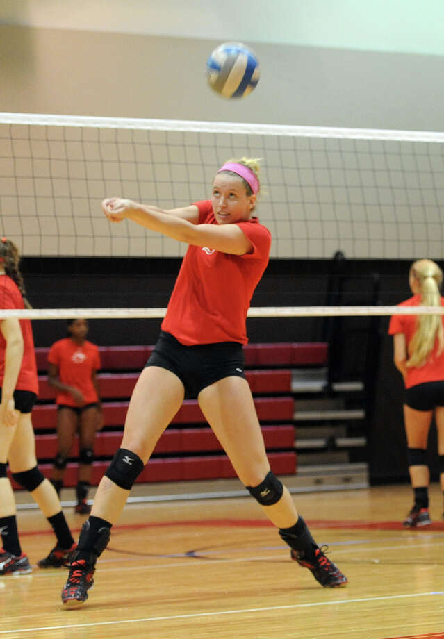 Lamar's Sara Landis volleys the ball during practice at the Cardinal's gym on Wednesday. Photo taken Wednesday, August 21, 2013 Guiseppe Barranco/The Enterprise Photo: Guiseppe Barranco, STAFF PHOTOGRAPHER / The Beaumont Enterprise