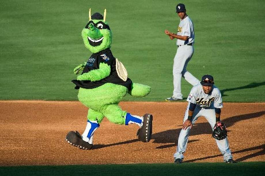 """Sugar Land Skeeters mascot """"Moe"""" rounds the bases between innings as the Skeeters play  at Constellation Field in Sugar Land."""