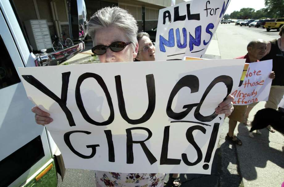 """Marianne Todey of Ames, Iowa, listens to Sister Simone Campbell speak during a Nuns on the Bus tour stop. U.S. nuns have been accused of """"radical feminism"""" by the Vatican."""