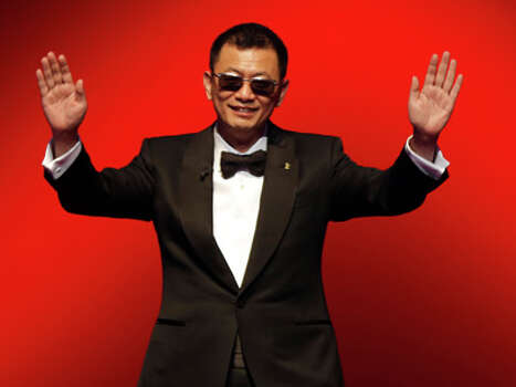 "FILE - In this Feb. 7, 2013 file photo, jury president Wong Kar Wai waves to the audience during the opening ceremony at the 63rd edition of the Berlinale, International Film Festival in Berlin. The acclaimed Hong Kong director crossed China meeting 100 kung fu masters as research for his new film about Bruce Lee's teacher, ""The Grandmaster."" He said that during demonstrations, it was normal for fighters to ""get knocked and fly"" across a room in the lightweight manner most of us only see in movies. Photo: AP"