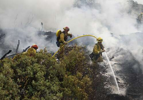 A crew works a fire zone inside Yosemite. The fire had spread into the national park, but not near popular Yosemite Valley. Photo: Paul Chinn, The Chronicle
