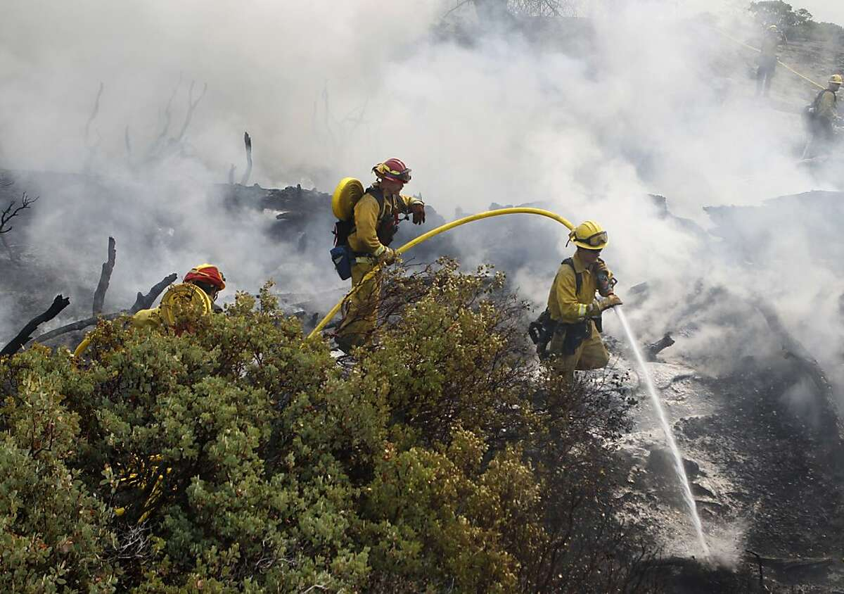 A crew works a fire zone inside Yosemite. The fire had spread into the national park, but not near popular Yosemite Valley.