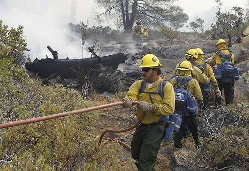 A fire crew approaches a burned zone from the Rim Fire inside Yosemite National Park on Friday, Aug. 23, 2013. The wildfire has scorched over 150 square miles of terrain. Photo: Paul Chinn, The Chronicle