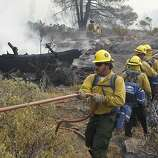 A fire crew approaches a burned zone from the Rim Fire inside Yosemite National Park on Friday, Aug. 23, 2013. The wildfire has scorched over 150 square miles of terrain.