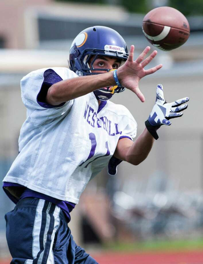 Westhill high school receiver Evan Skoparantzos catches a pass from quarterback Ryan Coppola during a preseason practice at Westhill high school, Stamford, CT on Friday, August 23rd, 2013. Photo: Mark Conrad / Stamford Advocate Freelance