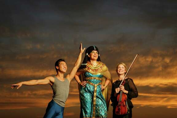 Jim Nowakowski of the Houston Ballet, left to right, Molly Searcy, of the Houston Opera and Martha Chapman of the Houston Symphony pose for a photo on top of the Downtown Aquarium, Monday, Aug. 19, 2013, in Houston. ( Michael Paulsen / Houston Chronicle )