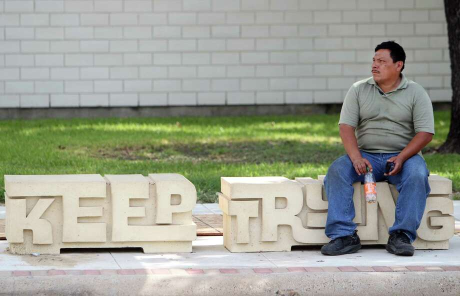 Jose Escobar sits on street art placed at the bus stop as part of the Navigation Boulevard Esplanade on Tuesday, Aug. 20, 2013, in Houston. The esplanade along Navigation Boulevard is between N. St. Charles Street and N. Paige Street which is meant to be an attraction for local residents and tourists of the East End. ( Mayra Beltran / Houston Chronicle ) Photo: Mayra Beltran, Staff / © 2013 Houston Chronicle