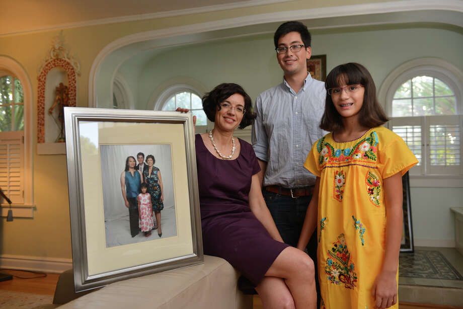 Leticia Ozuna with her children Ben Parafina, Nina Parafina, along with a photograph including their father, Sophia Parafina who who underwent sex reassignment surgery. Photo: Robin Jerstad